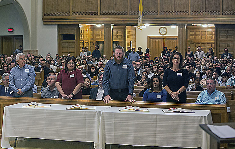 St. Elizabeth Ann Seton catechumens stand as Archbishop Thomas Wenski recognizes the groups from different churches during one of the two Rite of Election ceremonies celebrated March 1, 2020, at St. Mary Cathedral.