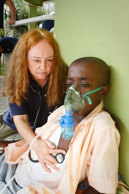 A medic works with a patient with breathing problems a few months after the Jan. 12, 2010 earthquake in Port-au-Prince, Haiti. Patients with coronavirus often need much more help to breathe: ventilators that are also in short supply.