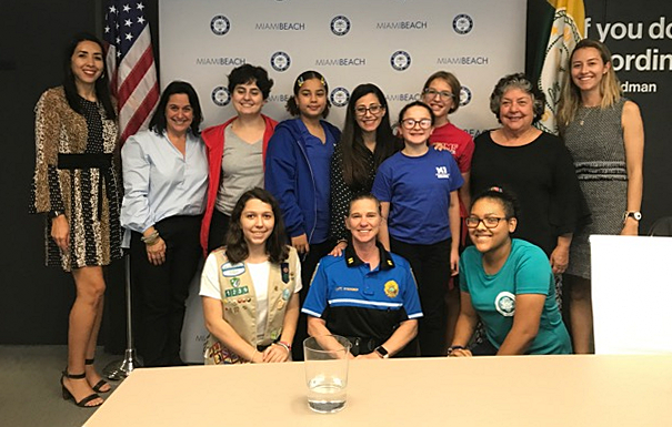 Madeleine Gonzales, lower left, poses with others in the Miami Beach leadership program. Madeleine, a senior student at Msgr. Edward Pace High School, has won a scholarship from the National Honor Society.