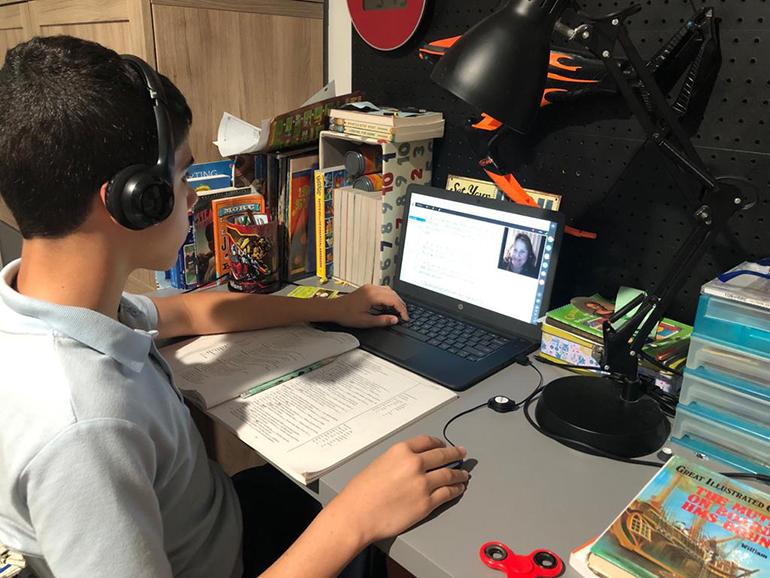 Joshua Piñero, 12, studies Latin online via Queen of Heaven Academy.