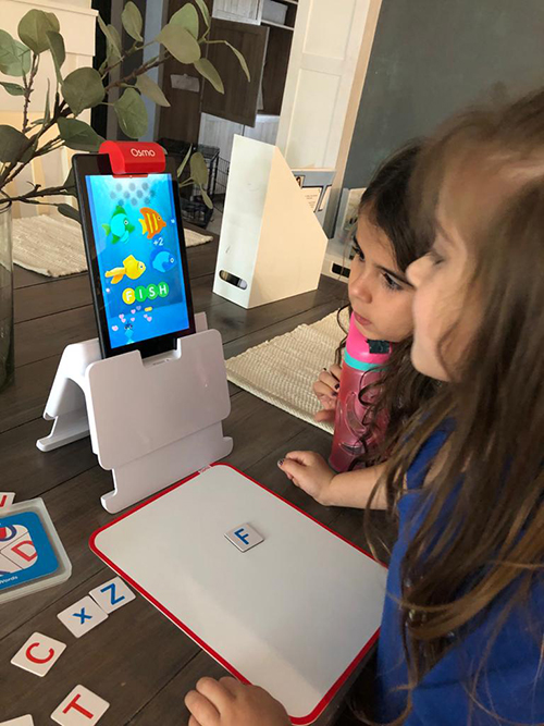 Emma and Ava Piñero use Osmo to play educational games.