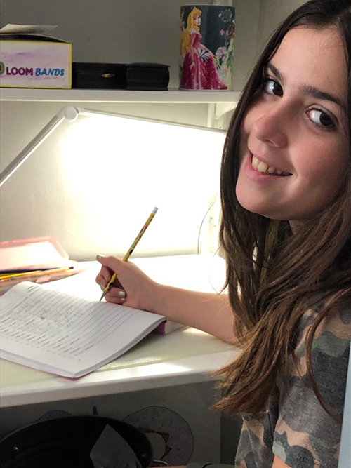 Brianna Piñero, 11, works on her Language Arts assignment.