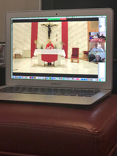 "This is how Dan Gonzalez, a parishioner at Our Lady of the Lakes in Miami Lakes, watched the Palm Sunday Mass April 5, 2020, alongside his mother and brother: ""We created a Zoom meeting and invited my mom and my brother. Once they all logged in, I opened the Mass livestream in my browser then shared my screen with those in the Zoom meeting. This way we all could see and hear the Mass and each other at the same time. Worked great! You could probably do this with any number of people in the Zoom meeting."""