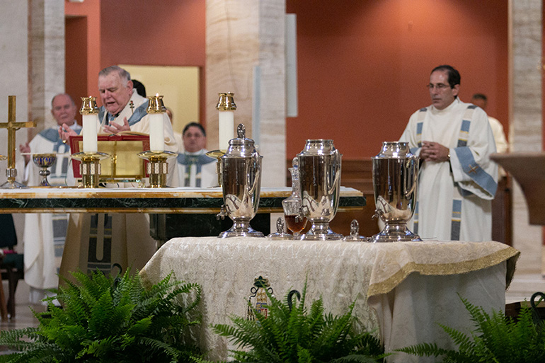 Archbishop Thomas Wenski, alone with the deans of the archdiocese, several bishops and priests, and two deacons, celebrates the Mass of Chrism in the midst of the coronavirus pandemic, on the Tuesday of Holy Week, April 7, 2020, at St. Mary Cathedral. The Mass was livestreamed on the Archdiocese of Miami's Facebook and YouTube sites.