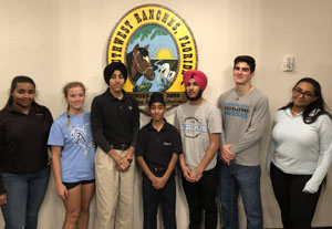 The Unity in Diversity 5K Production Committee Members pose for a photo at Southwest Ranches Town Hall. From left to right is Mesha Singh, of  NSU University School; Erika Castro, of Saint Thomas Aquinas High, Pavitpaul Makkar, from American Heritage, Japitpaul Makkar from Franklin Academy, Parneet Singh, of West Broward High, Nikolas Garcia, from Archbishop Edward A. McCarthy High, and Muskan Singh, from NSU University School.