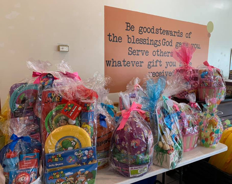 Easter baskets donated by St. Mark School students wait to be collected by families at New Horizon Methodist Church, neighbor to St. Mark Church in Southwest Ranches.