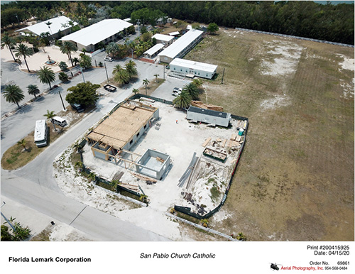 Aerial view, taken April 15, 2020, of the new rectory and office for San Pablo Church in Marathon, which is being built to replace the one damaged by Hurricane Irma in 2017. The church, which was not damaged, is visible at top left.