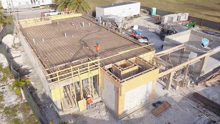 Workmen pour concrete to create the second floor of San Pablo Church's new rectory and office, April 21, 2020. The new construction is a result of the damages caused by Hurricane Irma in Marathon in 2017.