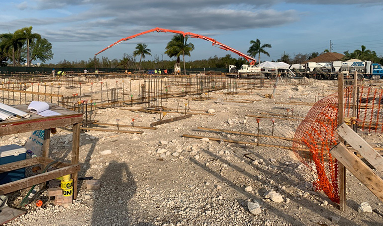 Early in the morning of May 7, 2020, an extended pump truck creates a rainbow over St. Peter Church in Big Pine Key, as it begins pouring 347 cubic yards of concrete to form the foundation for a new church. The old one was damaged by Hurricane Irma in 2017.