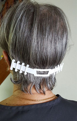 Plastic straps produced by Dakotah Herald via 3D printer relieve ear pressure from face masks.