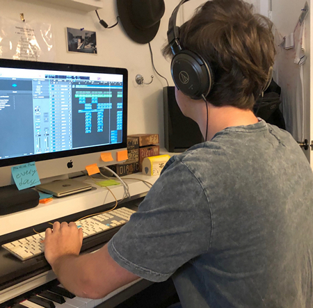 Pablo Amat, 17, a budding musician and student at Immaculata-La Salle High School in Miami, is shown here busy at work producing his music video.