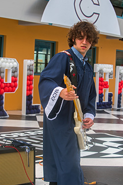Christopher Columbus High School graduate Joseph Rodriguez plays the national anthem on his electric guitar at the start of the graduation ceremony. Because of the pandemic, the Miami school celebrated its graduation at the Homestead Miami Speedway, June 20, 2020.