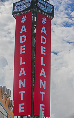 "The Explorers' motto, ""Adelante!"" is plastered on the board at the Homestead Miami Speedway. Because of the pandemic, Christopher Columbus High School celebrated its graduation at the Homestead Miami Speedway June 20, 2020."