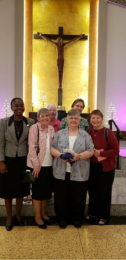 Franciscan Sisters of Allegany and some of their Miami Associates pose after the farewell Mass celebrated for them at Corpus Christi Church in Wynwood, where up to 90 sisters served over the years. Pictured in front, from left: Sister Lucy Cardet, Sister Michele Dolyk, and associate Marcia Gill. Back row, from left: associates Elysee Manshia, Pat Fairfield and Ella Pulido.