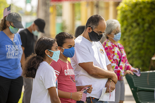 Blessed Trinity parishioner Lino De La Cruz and his daughters, from left, Jaylin and Alina, pray during the Unity Prayer Walk on June 27, 2020. The walk united people of faith from the area to peacefully pray for justice and reconciliation.