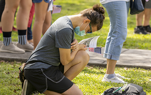 Naty Marie from Crossbridge Church in Miami Springs prays during the Unity Prayer Walk on June 27, 2020. The walk united people of faith from the area to peacefully pray for justice and reconciliation.