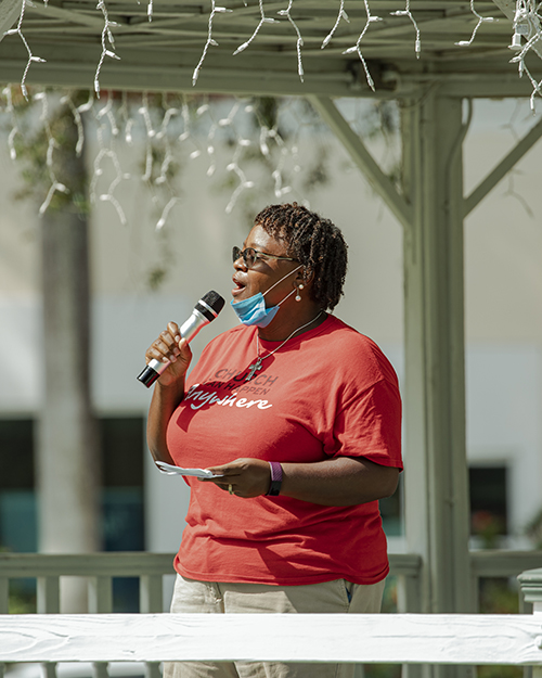 Rev. Ginger Medley, pastor of Poinciana United Methodist Church in Miami Springs, sings during the Unity Prayer Walk on June 27, 2020.