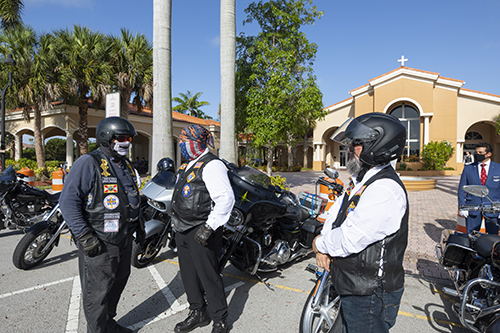 Archbishop Thomas Wenski, far left, talks to members of the Knights of Columbus Council 14390 and members of the Knights on Bikes outside St. John XXIII Church in Miramar, before departing on their two-hour motorcycle caravan to Ave Maria in the Diocese of Venice in west Florida, July 3, 2020.