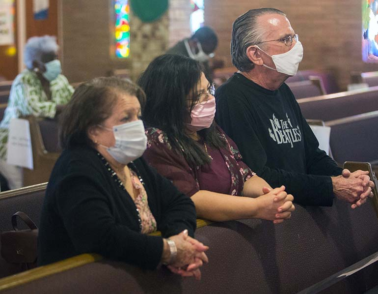 Nancy Blanco, Elaine Kennedy and Edward Kennedy came from Kendall to attend the Mass for unity against racism and for peace, celebrated by Archbishop Thomas Wenski July 5, 2020, at Holy Redeemer Church in Liberty City.