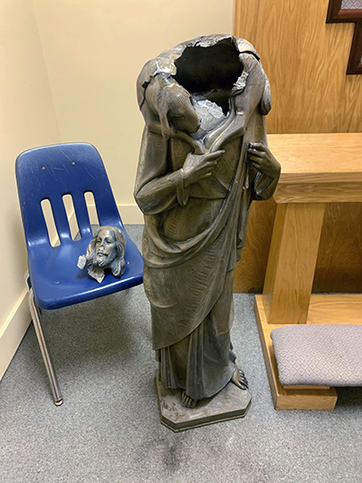 This statue of Christ as the Good Shepherd was decapitated sometime between the evening of July 14 and the morning of July 15, 2020, outside Good Shepherd Church in Kendall. Archbishop Thomas Wenski has asked that the incident be investigated as a hate crime.