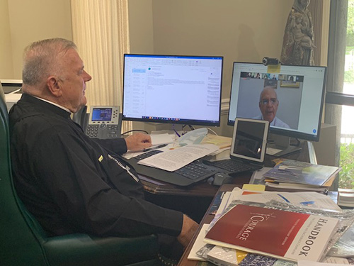 "Archbishop Thomas Wenski listens via Zoom to Bishop Mario Moronta of Venezuela during the international conference put on by the Academy of Catholic Leaders of Latin America in which he participated July 20, 2020. The theme of the conference was ""Challenges facing the Church after the worldwide pandemic: The view from Venezuela and the U.S."""