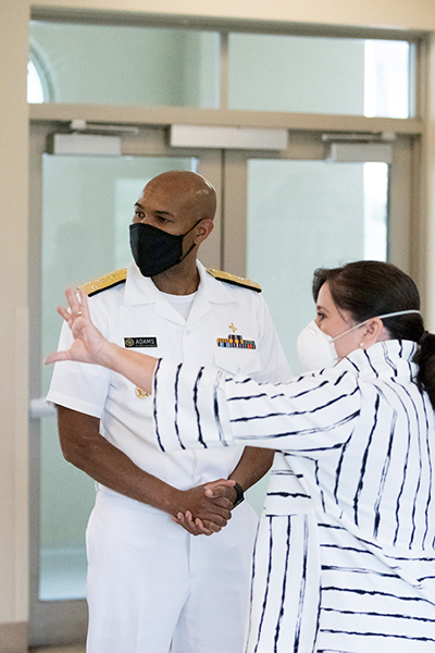 Dr. Jerome Adams, the 20th U.S. surgeon general, talks with Hilda Fernandez, CEO of Camillus House shelter for the homeless in Miami, during a visit to South Florida on July 23, 2020.