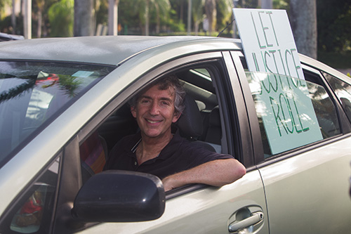 David Schatfield, of St. Stephen's Episcopal Church, sits in his car and listens to speakers during PACT's July 27, 2020 drive-in rally at Coral Gables Congregational Church.