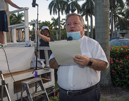 Father Juan Sosa, pastor of St. Joseph Church on Miami Beach, closes PACT's drive-in rally with a prayer, July 27, 2020.