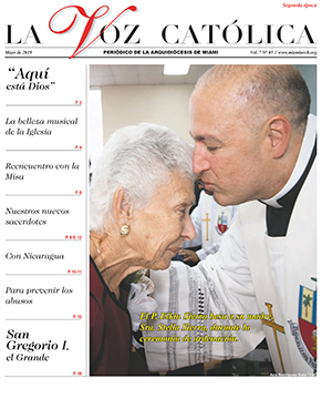 Newly ordained Father Elkin Sierra kisses his mom in this second-place winning picture featured on the cover of La Voz Catolica.