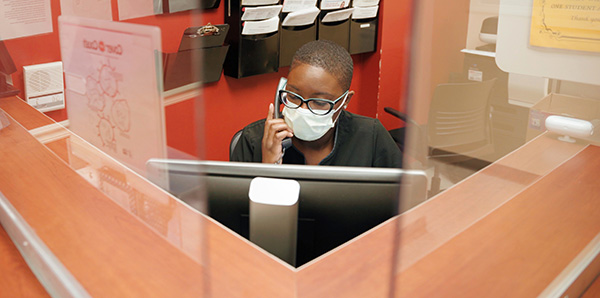 At Barry University, Plexiglas dividers have been installed at desks where office workers deal with students or the public.