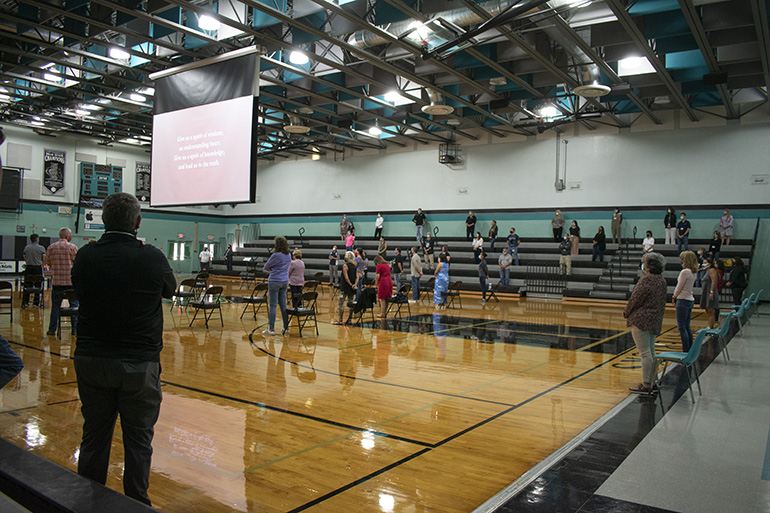 Socially distanced teachers take part in Mass at Archbishop McCarthy High in Southwest Ranches at the start of the 2020-2021 academic year.