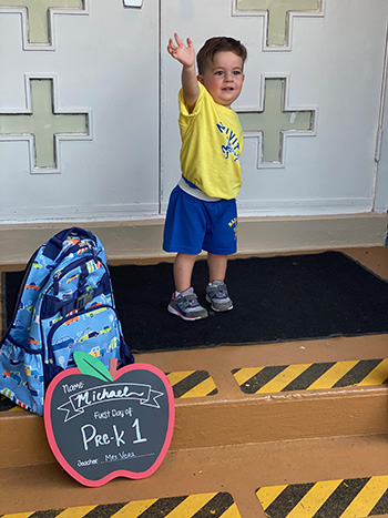 A PreK1 student waves before entering Joanna Vera's class at Nativity School in Hollywood on the first day of school, Aug. 19, 2020. PreK students were allowed to resume in-person classes at archdiocesan schools, while K-12 students returned only virtually.