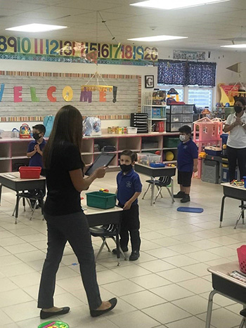 Photo of a socially distanced PreK3 classroom at Our Lady of Lourdes School, Miami, on the first day of school, Aug. 19, 2020.