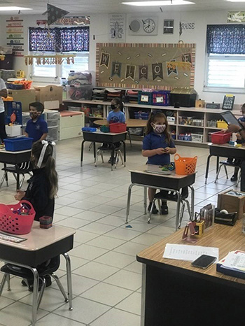 Photo of a socially distanced PreK4 classroom at Our Lady of Lourdes School, Miami, on the first day of school, Aug. 19, 2020.