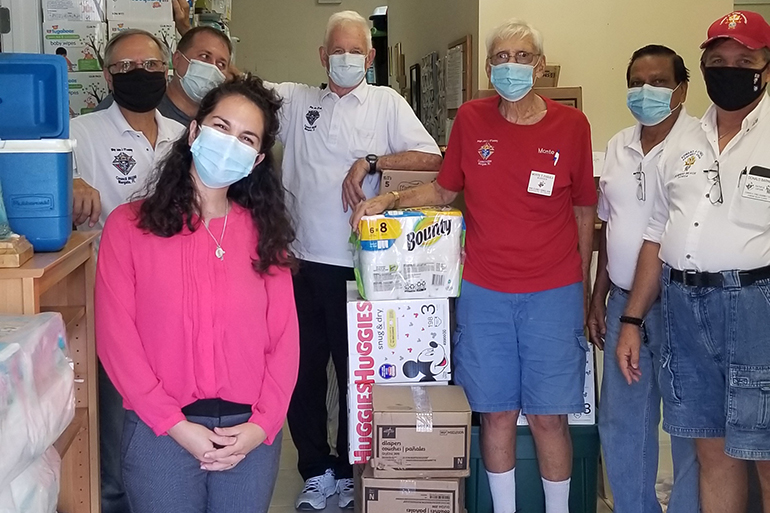In late July, members of several Miami-area Knights of Columbus councils pitched in to help deliver some 20 pallets of baby supplies to area pregnancy help centers in the Archdiocese of Miami, according to James Buzzella, state disaster response coordinator for the Knights of Columbus in Miami. Some of the Knights are shown here posing with Katherine Lantigua, program coordinator of the South Broward Pregnancy Help Center.