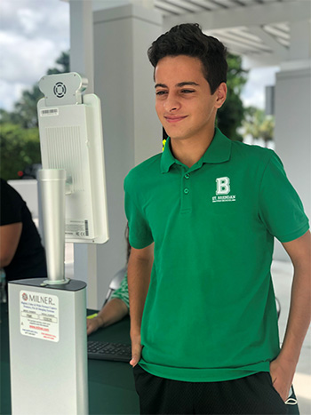 Freshman Nicholas Kanarek is registered and scanned at one of St. Brendan High School's new Thermoscan kiosks. The kiosks are placed at key entry points throughout campus so that when students return to school physically, the device will automatically scan their temperature with name and picture and allow them to proceed to their classroom. All faculty and staff are already using the system once they arrive to work. The kiosks recognize the face with or without a face mask.