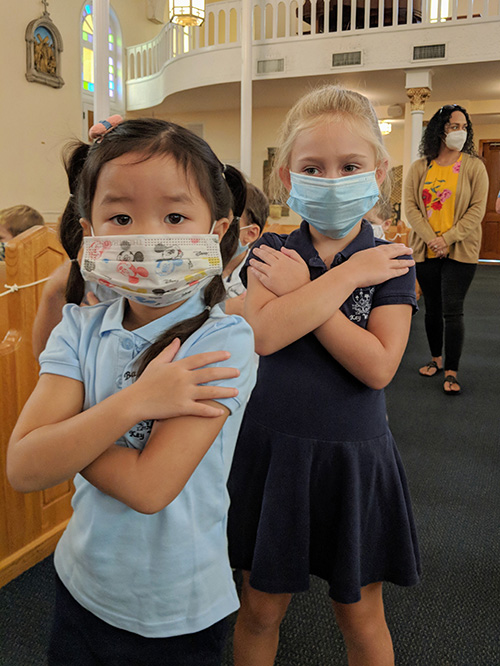 Students in preschool at The Basilica School of St. Mary Star of the Sea in Key West receive blessings as they return back to school in August 2020.