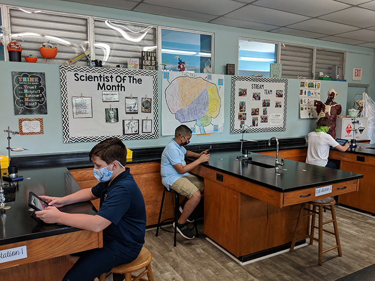 Students at the Basilica School of St. Mary Star of the Sea do some work in a science lab. The school just became one of only four in the Archdiocese of Miami, and nine in the state of Florida, to earn STREAM certification.