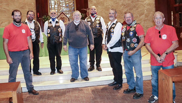 Members of Knights on Bikes pose for a picture with Archbishop Thomas Wenski after celebrating Mass at St. Martha Church Sept. 17, 2020. From left: Tony Orband, Mario Rangel, Sergio Alfonso, Archbishop Wenski, George Gutierrez, Raul Cruz Alvarez, Lance Maki and Dale Saunders. The Knights stopped at the archdiocesan Pastoral Center while riding to northern Florida along U.S. 1 to raise awareness about the rights enshrined in the First Amendment to the U.S. Constitution, notably freedom of religion and speech.