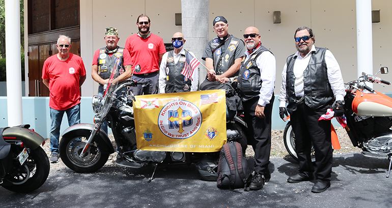 Knights on Bikes from the Archdiocese of Miami pose with members of the Knights on Bikes of Illinois in front of St. Martha Church, Miami Shores, Sept. 17. 2020. From left: Dale Saunders, Lance Maki, Tony Orband, Sergio Alfonso, Father James Heyd, George Gutierrez and Mario Rangel. The Knights stopped at the Pastoral Center and celebrated Mass with Archbishop Thomas Wenski at St. Martha Church next door. They were riding to northern Florida along U.S. 1, to raise awareness about the rights enshrined in the First Amendment to the U.S. Constitution, notably freedom of religion and speech.