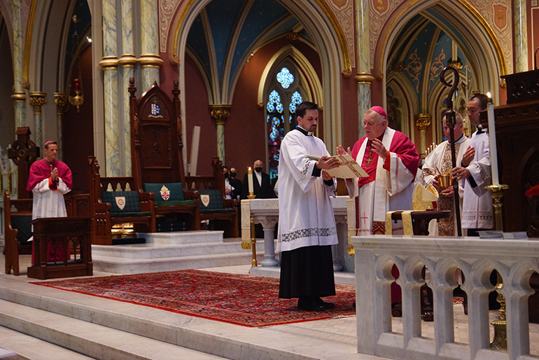 Archbishop Thomas Wenski blesses the new miter and crozier of Savannah's Bishop-elect Stephen Parkes (far left) during vespers Sept. 22, 2020 in the Cathedral of St. John the Baptist, Savannah.  During his tenure as bishop of Orlando, Archbishop Wenski had named Bishop Stephen Parkes, and his brother, St. Petersburg Bishop Gregory Parkes, as pastors of two newly established parishes.