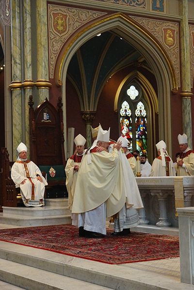Archbishop Thomas Wenski greets newly ordained Savannah Bishop Stephen Parkes at his ordination and installation Sept. 23, 2020 at the Cathedral of St. John the Baptist in Savannah. During his tenure as bishop of Orlando, Archbishop Wenski had named Bishop Stephen Parkes, and his brother, St. Petersburg Bishop Gregory Parkes, as pastors of two newly established parishes.
