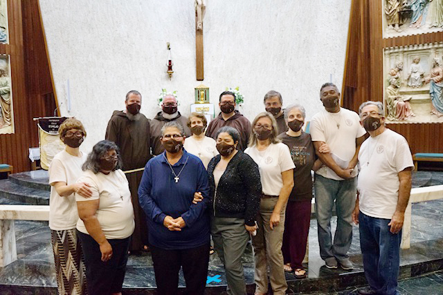 After the rite of admission of a new member to the Secular Franciscan Order – Espejo de Cristo (Mirror of Christ) all fraternity members pose with members of the Order of Friars Minor assigned to the recently erected St. Pio Friary located on the grounds of St. Jerome Parish in Fort Lauderdale, last September at Immaculate Conception Parish in Hialeah.