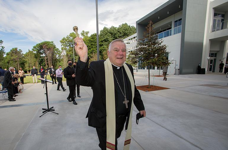 Archbishop Thomas Wenski blesses the Gus Machado School of Business complex at St. Thomas University, Oct. 16, 2020.