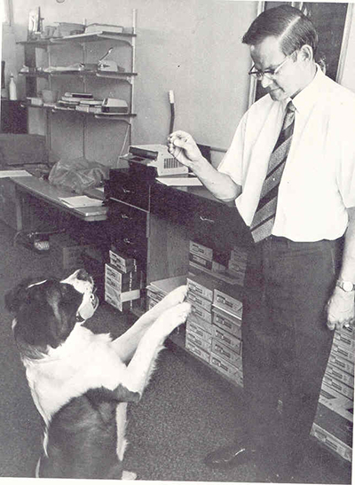 Marist Brother Eugene Trzecieski is shown here with his dog, Brandy, a St. Bernard that won the hearts of the students at Christopher Columbus High School and became the school's mascot.