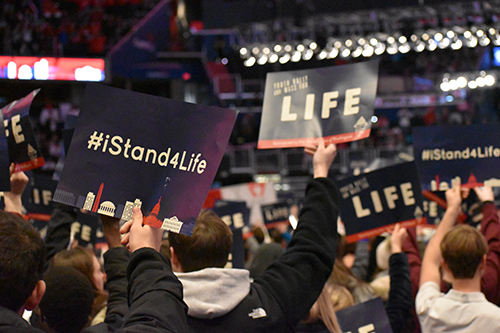 "Students hold up pro-life signs before a Mass celebrated at the Capital One Arena ahead of the 2020 March for Life, Jan. 24, 2020. In his new encyclical, Fratelli tutti, Pope Francis cites wars, the ""throwaway culture"" that includes abortion and euthanasia, neglect of the elderly, discrimination against women, and slavery, among other threats facing humanity."