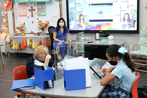 Jennifer Sardina teaches the second graders sitting before her in class as well as students learning at home online. St. Bonaventure School opened its campus at the end of September and welcomed students back to the classrooms. Some are still participating in virtual classes due to the pandemic.
