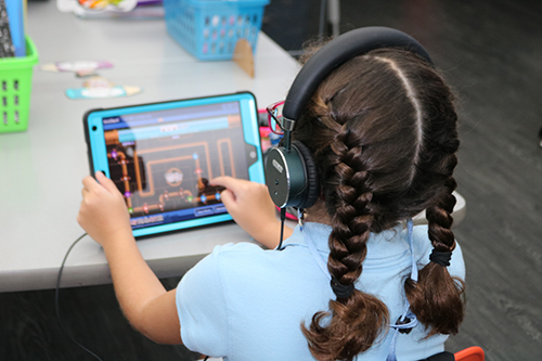 A second grader works on an assignment during classes at St. Bonaventure School in Davie using her iPad.