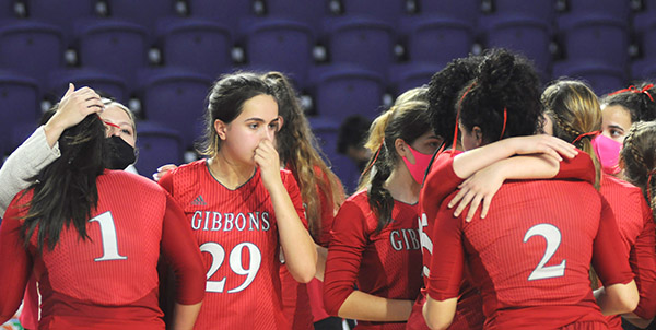 Cardinal Gibbons players, including Valeria Lozada (1), Emma O'Keeffe (29) and Dylan Andrews (2), console each other after their loss to Bishop Kenny in the FHSAA Class 4A volleyball state final match Nov. 15, 2020 2020 at Suncoast Credit Union Arena in Fort Myers. Bishop Kenny defeated Cardinal Gibbons 29-27, 25-18, 17-25, 25-20 to win their third state title.