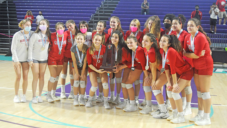 Cardinal Gibbons players pose for a team photo after the FHSAA Class 4A volleyball state final match Nov. 15, 2020 at Suncoast Credit Union Arena in Fort Myers. Bishop Kenny defeated Cardinal Gibbons 29-27, 25-18, 17-25, 25-20 to win their third state title.